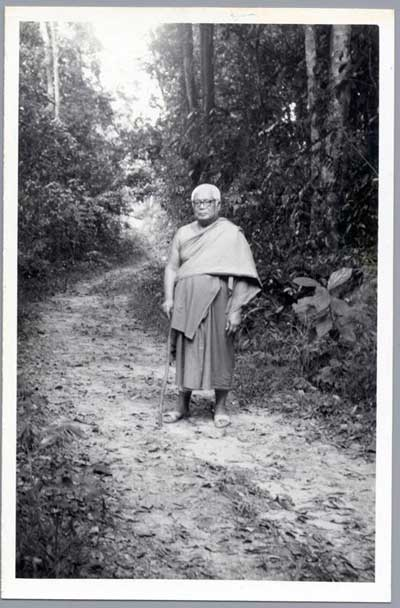 tan ajarn standing with cane
